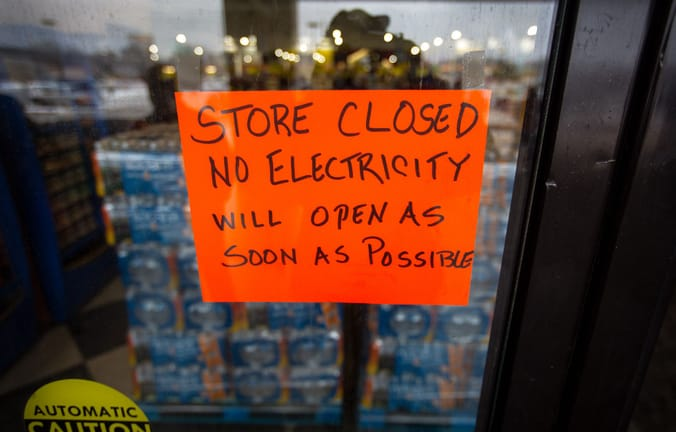 """sign: """"store closed no electricity will open as soon as possible"""""""