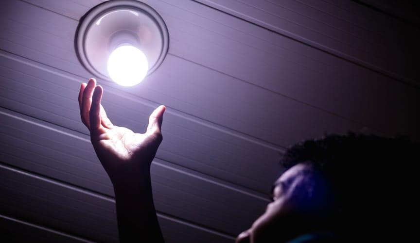 man putting in light bulb